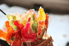 Colorful lollipops cockerels. In a basket Royalty Free Stock Photos
