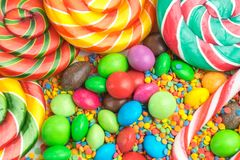 Colorful lollipops and different colored candy closeup royalty free stock photos