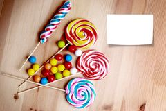 Colorful lollipops and different colored round candy. Royalty Free Stock Photography