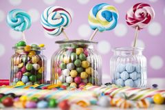 Mixed colorful sweets, lollipops and candy. Colorful lollipops and different colored round candy and gum balls Stock Photo