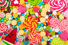 Colorful lollipops and different colored round candy. Royalty Free Stock Image