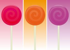 Colorful Lollipops over different color background Royalty Free Stock Photography