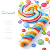 Colorful lollipops and smarties Stock Photos