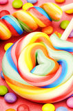 Colorful lollipops and smarties Stock Photography