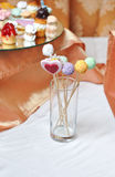 Colorful lollipops on white table. Heart and round shaped lollipops Royalty Free Stock Image