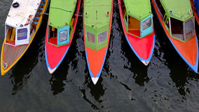 Colorful long boats. In the river Stock Photography
