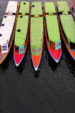 Colorful long boats vertical. Colorful long boats in the river ,vertical picture Stock Photo