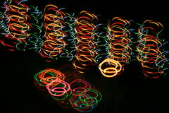 Colorful long exposure lights painting. With multicolored bulb Stock Photos