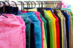 Colorful long pants jean with hangers Royalty Free Stock Images