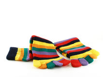 Close-up colorful striped long socks isolated on white background. Colorful striped long socks, teenage female winter fashion Stock Image