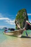 Colorful long tail boats at beautiful Ao Nang beach on a backgro Royalty Free Stock Images