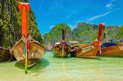 Colorful long tail boats, Maya Bay beach, Thailand. PHI PHI, THAILAND - NOVEMBER 23, 2015: Colorful long tail boats at Maya Bay heavenly beach on a background of Stock Images
