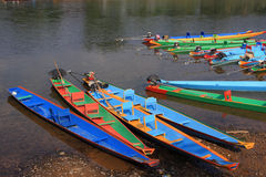 Colorful long-tailed boats at riverside Royalty Free Stock Images