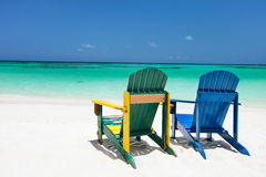 Colorful lounge chairs at Caribbean beach Royalty Free Stock Photo