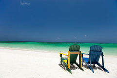 Colorful lounge chairs at Caribbean beach Royalty Free Stock Photos