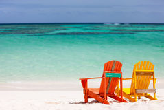 Colorful lounge chairs at Caribbean beach Royalty Free Stock Photography