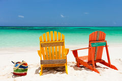 Colorful lounge chairs at Caribbean beach Stock Photography