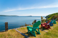 Colorful lounge chairs with a view of beautiful scenic panorama Stock Images