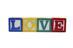 Toy Blocks Spell Love - Isolated on White Royalty Free Stock Photos
