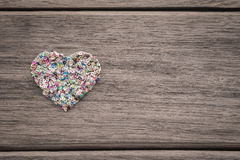 Colorful love heart on wood background with space for text Royalty Free Stock Photos