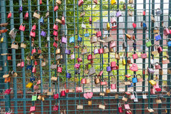 Colorful love locks on the fence as concept for love Stock Photos