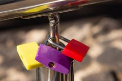 Colorful love locks on a handrail. Some colorful love locks on a handrail of a bridge royalty free stock photos