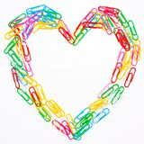 Colorful love symbol. From Colourful paperclip isolated on white background stock photos