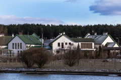 Colorful low-rise buildings. Againsr cloudy sky on river bank Royalty Free Stock Photos