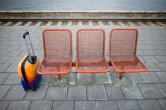 Colorful luggage near the bench. Railway station. stock photo