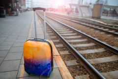 Colorful luggage near the railroad. Railway station. royalty free stock images