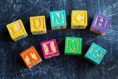 Colorful lunch wooden blocks. On the wooden background Royalty Free Stock Image