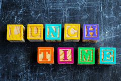 Colorful lunch wooden blocks. On the wooden background Royalty Free Stock Photo
