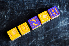 Colorful lunch wooden blocks. On the wooden background Stock Photography