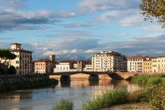Colorful Lungarno over the river Arno in Pisa Italy royalty free stock images