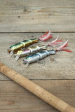 Colorful lures with the fishing rod on the wooden pier Stock Photography