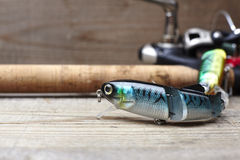 Colorful lures with the fishing rod on the wooden pier Royalty Free Stock Photo