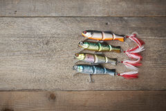 Colorful lures on the wooden pier Stock Image