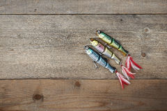 Colorful lures on the wooden pier Stock Photos