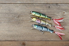 Colorful lures on the wooden pier Royalty Free Stock Photo