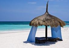Colorful luxurious beach palapa. A colorful and luxurious palapa, on a Caribbean beach Stock Photos