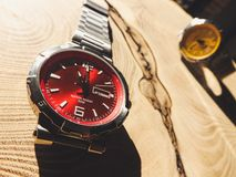 Colorful luxury watches on wood table royalty free stock photos