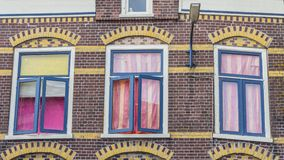 Colorful lwindows with curtains Stock Images
