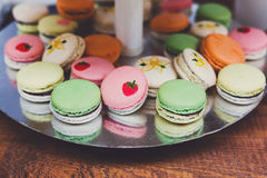 Colorful macaron cookies on bar for sale. Beautiful Macarons choice. Plenty of colorful french cookies, meringue based confectionery desserts on counter bar for Royalty Free Stock Image