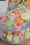 Colorful macaron cookies on bar for sale. Beautiful Macarons choice. Plenty of colorful french cookies, meringue based confectionery desserts on counter bar for Royalty Free Stock Photo