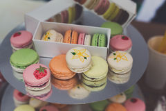 Colorful macaron cookies on bar for sale. Beautiful Macarons choice. Plenty of colorful french cookies, meringue based confectionery desserts on counter bar for Royalty Free Stock Photos