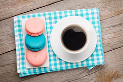 Colorful macaron cookies and cup of coffee Stock Image