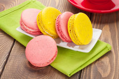 Colorful macaron cookies and cup of coffee Stock Photography