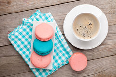 Colorful macaron cookies and cup of coffee Stock Photos