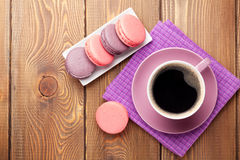 Colorful macaron cookies and cup of coffee Stock Images
