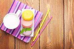 Colorful macaron cookies and cup of milk Royalty Free Stock Image